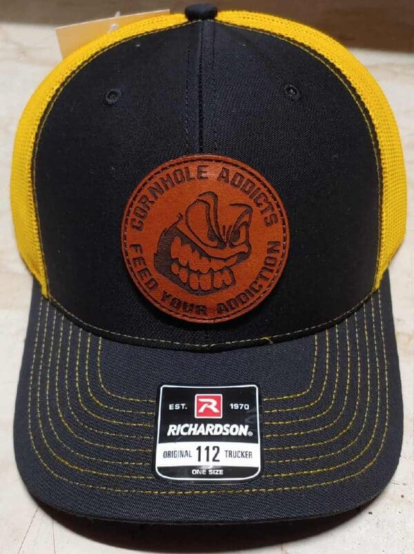 Black on gold leather patch hats