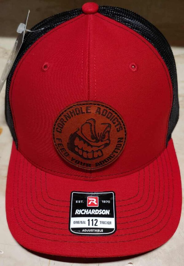 Red on black leather patch hats